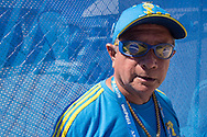 A gate attendant wearing Brazil team glasses in the Arena da Amazonia, Manaus, Brazil, ahead of the England v Italy World Cup 2014 group match. Photo by Andrew Tobin/Tobinators Ltd