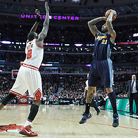 26 March 2012: Denver Nuggets small forward Wilson Chandler (21) takes a jumpshot over Chicago Bulls small forward Luol Deng (9) during the Denver Nuggets 108-91 victory over the Chicago Bulls at the United Center, Chicago, Illinois, USA. NOTE TO USER: User expressly acknowledges and agrees that, by downloading and or using this photograph, User is consenting to the terms and conditions of the Getty Images License Agreement. Mandatory Credit: 2012 NBAE (Photo by Chris Elise/NBAE via Getty Images)