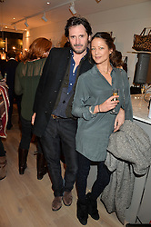 CHARLIE GARDNER and LORRAINE VAN WYK at a party hosted by Melissa Del Bono to celebrate the launch of her Meli Melo flagship store at 324 Portobello Road, London W10 on 28th November 2013.