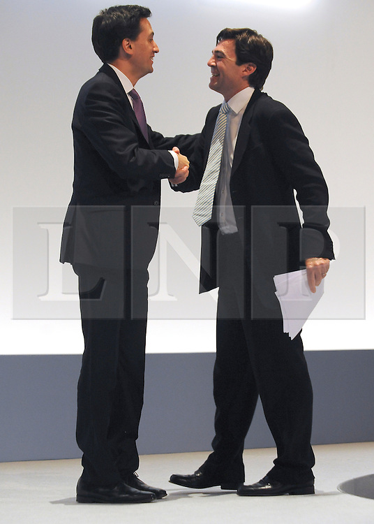 © Licensed to London News Pictures. 28/09/2011. LONDON, UK. Ed Miliband, Leader of the Labour Party shakes hands with Andy Burnham MP Shadow Secretary of State for Education after he addresses The Labour Party Conference in Liverpool today (28/09/11). Photo credit:  Stephen Simpson/LNP