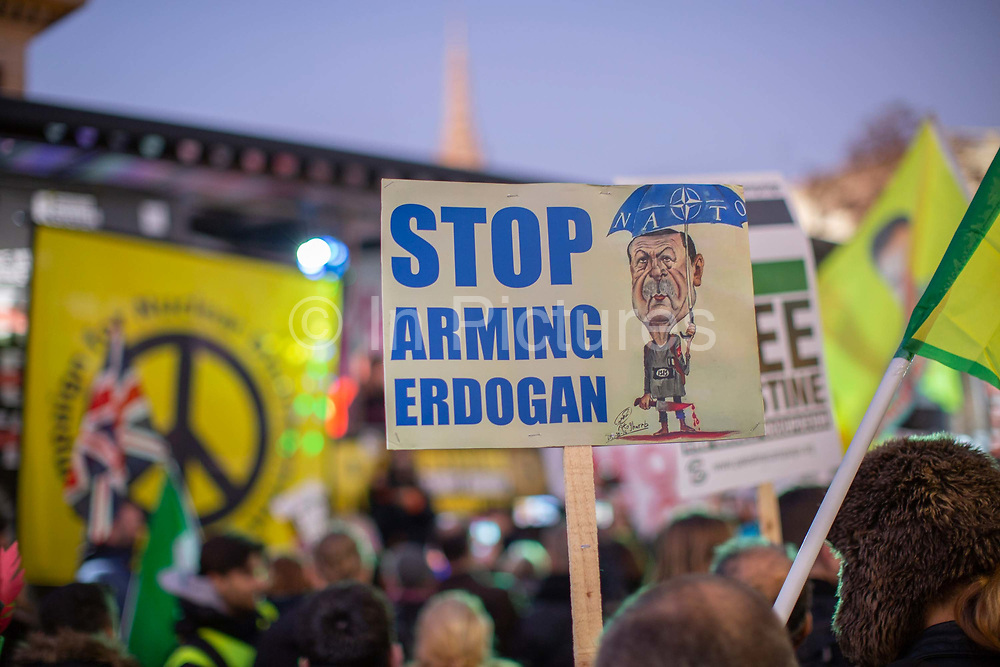 A Stop Arming Erdogan placard during the Stop Trump Coalition and CND protest against U.S. President Donald Trump UK visit to attend the NATO North Atlantic Treaty Organisation summit on the 3rd December 2019 in London in the United Kingdom. Ahead of a British national election on 12th December 2019, Stop Trump Coalition and CND, Campaign for Nuclear Disarmament organised a protest to target a banquet at Buckingham Palace where Trump will dine with the Queen and other NATO leaders. The U.K. is hosting NATO summit to mark the military alliances 70th anniversary.