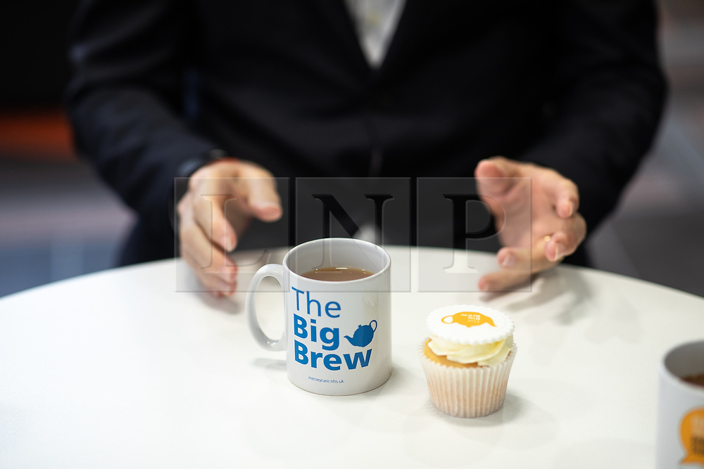 © Licensed to London News Pictures. 18/01/2019. Liverpool , UK. Liverpool Metro Mayor STEVE ROTHERHAM (c) with a Big Brew mug and cupcake . Ava Max's number one single , Sweet but Psycho , has been criticised by the Zero Suicide Alliance (ZSA), a suicide prevention campaign group . In an open letter to the pop star and UK broadcasters , co-signed by Liverpool Mayor Steve Rotherham and Luciana Berger MP , the ZSA say the song's lyrics and the video's imagery reinforce negative perceptions about people with mental health issues and undermines their effort to combat stigma , which can prevent suicidal people from seeking help , with potentially life-threatening consequences . Photo credit: Joel Goodman/LNP