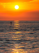 Paddle Boarding At Sunset