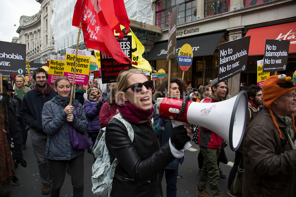 Demonstrator shouting into a megaphone at Anti-racism Day demonstration led by Stand Up To Racism on 19th March 2016 in London, United Kingdom. Stand Up To Racism has led some of the biggest anti-racist mobilisations in Britain of the last decade, making a stand protesting against racism, Islamophobia, anti-Semitism and fascism.
