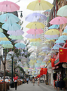 SHENYANG, CHINA - AUGUST 26: (CHINA OUT) <br /> <br /> Street Decorated With Umbrellas In Shenyang<br /> <br /> Thousands of umbrellas hang across a street to greet the 12th National Games of China on August 26, 2013 in Shenyang, Liaoning Province of China. <br /> ©Exclusivepix