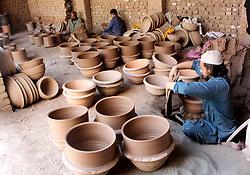 May 4, 2017 - Peshawar, Pakistan - Pakistani workers make traditional pottery items at a workshop on the outskirts of Peshawar, Pakistan. (Credit Image: © Muhammad Hadi/Xinhua via ZUMA Wire)
