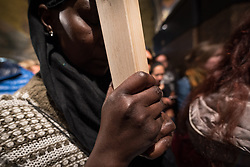 19 April 2019, Jerusalem: A woman prays in the Church of the Holy Sepulchre. Thousands of Christians march the Via Dolorosa on Good Friday, marking the stations of the cross in the Jerusalem Old City, in memory of the path Jesus walked carrying his cross towards his crucifixion.