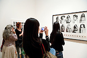 female persons looking at a photograph exhibition Museum of modern Art New York