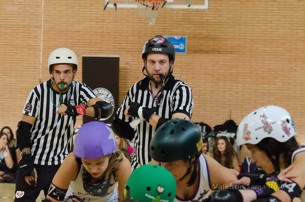 Madrid, Spain. 15th October, 2016. Referees following the movements of the players of Roller Derby Madrid and The Rolling Candies.