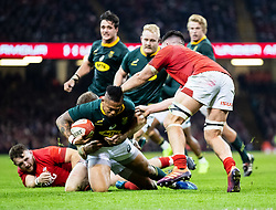 Elton Jantjies of South Africa is tackled by Hadleigh Parkes of Wales<br /> <br /> Photographer Simon King/Replay Images<br /> <br /> Under Armour Series - Wales v South Africa - Saturday 24th November 2018 - Principality Stadium - Cardiff<br /> <br /> World Copyright © Replay Images . All rights reserved. info@replayimages.co.uk - http://replayimages.co.uk