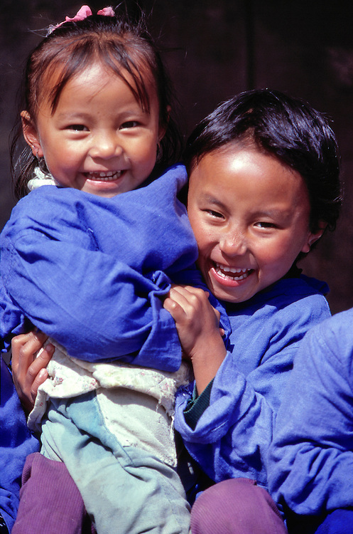Young children play at the Tibetan Refugee Center in Darjeeling in northern India.