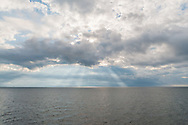 Sun Breaking though clouds , Oreint, Long Island Sound, Oreint Ferry view from, Long Island, New York