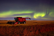 Photo Randy Vanderveen<br /> Grande Prairie, Alberta<br /> 2020-09-29<br /> The northern lights colour the sky behind a combine parked for the night east of LaGlace Tuesday. The display has been active the past few nights.