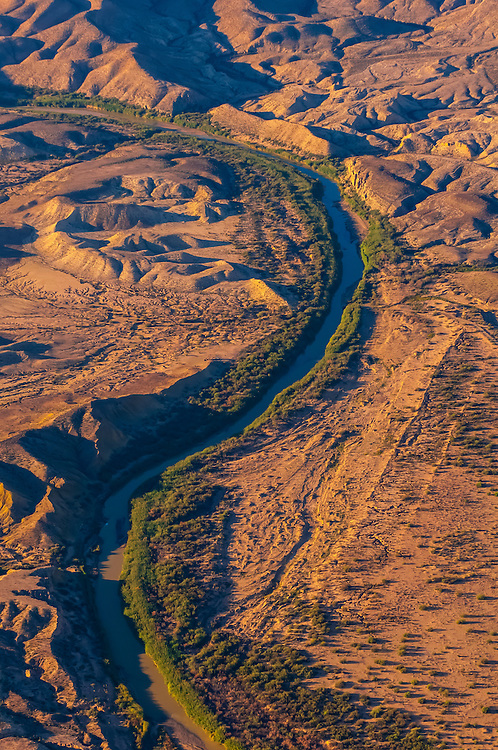 Aerial view taken over Big Bend National Park, Texas USA looking to the Rio Grande River, which is the border between the U.S. and Mexico. Mexico is on the right side of the river.