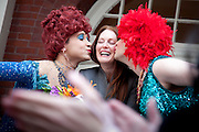 Hasty Pudding Theatrical's Woman of the Year, Julianne Moore, gets kisses from organization members during a celebration in Cambridge, Massachusetts.