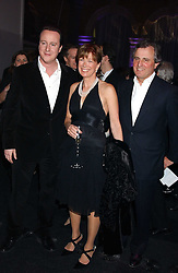 Leader of the Conservative Party DAVID CAMERON MP,  his mother in law VISCOUNTESS ASTOR and VISCOUNT ASTOR at the Conservative Party's Black & White Ball held at Old Billingsgate, 16 Lower Thames Street, London EC3 on 8th February 2006.<br /><br />NON EXCLUSIVE - WORLD RIGHTS