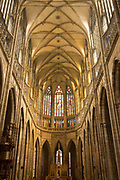 Nave Of St Vitas Cathedral in Prague Castle, on 18th March, 2018, in Prague, the Czech Republic. The Metropolitan Cathedral of Saints Vitus, Wenceslaus and Adalbert is a Roman Catholic metropolitan cathedral in Prague, the seat of the Archbishop of Prague. Until 1997, the cathedral was dedicated only to Saint Vitus, and is still commonly named only as St. Vitus Cathedral. This cathedral is a prominent example of Gothic architecture and is the largest and most important church in the country. It is located within Hradcany-Prazsky Hrad Prague Castle in the Czech capital.