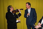 VIOLINIST BELA HORVATH OF AVASI, HUNGARIAN GYPSY BAND; DAVID CAMERON, Launch of ' More Human'  by Steve Hilton. Second Home, Shoreditch. London. 19 May 2015.