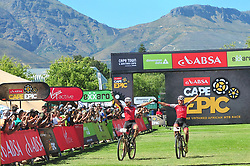 WELLINGTON SOUTH AFRICA - MARCH 22: Centurion Vaude's Nicola Rohrbach and Daniel Geismeyr celebrate winning stage three's 111km from Wellington to Worcester on March 22, 2018 in Western Cape, South Africa. Mountain bikers gather from around the world to compete in the 2018 ABSA Cape Epic, racing 8 days and 658km across the Western Cape with an accumulated 13 530m of climbing ascent, often referred to as the 'untamed race' the Cape Epic is said to be the toughest mountain bike event in the world. (Photo by Dino Lloyd)