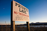 "A no trespassing sign for a ""Private Lake"" warns that ""This is not the Boulder Reservoir"" from its perch overlooking Boulder Reservoir outside Boulder, Colorado."