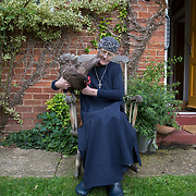 Hermit Sister Rachel Denton sits with her chicken in the garden of St Cuthberts' Hermitage in Lincolnshire, north east Britain August 24, 2015. Sister Rachel Denton has vowed to spend the rest of her life living as a consecrated hermit in the Catholic faith. A hermit is a person who chooses to live alone, with the intention of finding God. Rarely leaving her house she lives a life of prayer and solitude. However, she uses the internet and social media to share her experience and distance her self from physically interacting with society. REUTERS/Neil Hall