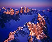 Winter aerial view of granite faces of the Cathedral Spires, Kichatna Mountains, Alaska Range, Denali National Preserve, Alaska.