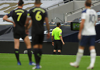 Football - 2020 /2021 Premier League - Tottenham Hotspur vs Newcastle United<br /> <br /> Referee, Peter Bankes  checking VAR for a possible penalty in injury time, which he awarded at the Tottenham Hotspur Stadium.<br /> <br /> COLORSPORT/ANDREW COWIE