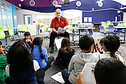 Second grade teacher Gabriel Roldan works with students in the new Learning Center at Pomeroy Elementary School in Milpitas, California, on February 2, 2015. (Stan Olszewski/SOSKIphoto)