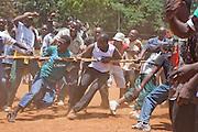 Men engage in a game of tug-of-war in the Kibera slum, Nairobi Kenya. Kibera is Africa's biggest slum with nearly one million inhabitants.