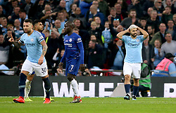 Manchester City's Sergio Aguero (right) reacts after his goal is ruled offside during the Carabao Cup Final at Wembley Stadium, London.
