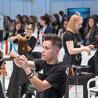 Participants compete in hair styling during the EuroSkills European Championship of young professionals in Budapest, Hungary on Sept. 26, 2018. ATTILA VOLGYI