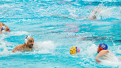 Pascal Janssen of the Netherlands in action against Drasko Brguljan of Montenegro during the Olympic qualifying tournament. The Dutch water polo players are on the hunt for a starting ticket for the Olympic Games on February 19, 2021 in Rotterdam
