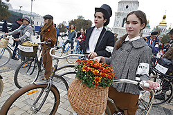 October 8, 2016 - Kiev, Ukraine - Participants with their bikes attend ''Tweed run'' or '''Retro Cruise'' on the St. Sophia Square in Kiev, Ukraine,on 08 October 2016. The participants are dressed in tweed jackets,wool golf socks and trousers, based on the British model,and ride on vintage bikes. (Credit Image: © Serg Glovny via ZUMA Wire)
