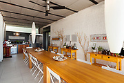 Interior of house, domestic kitchen with long wooden dining table