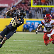 Dec 27 2017 - Santa Clara, CA U.S.A. Purdue wide receiver Gregory Phillips (10) game stats 14 catches for 149 yards and 2 touchdowns makes a great catch for a short gain during the NCAA Football Foster Farm Bowl game between Arizona Wildcats and the Purdue Boilermakers 38-35 win at Levi Stadium Santa Clara Calif. Thurman James / CSM