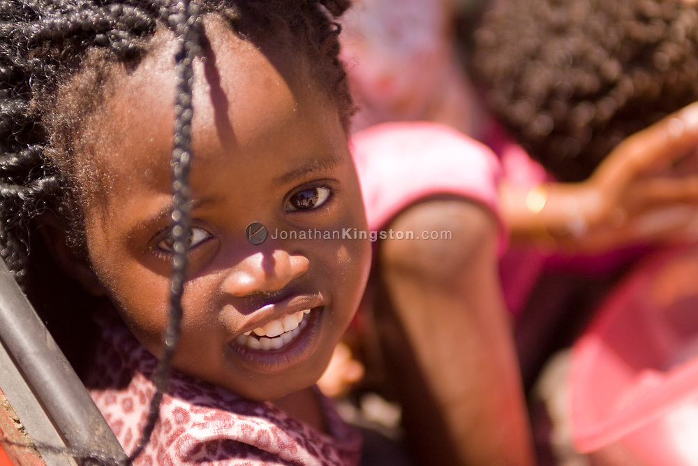 A young girl with braids in Cape Town township, South Africa.