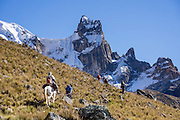 Our donkey train ascends Punta Cuyoc pass beneath Nevados Puscanturpa. Day 5 of 9 days trekking around the Cordillera Huayhuash in the Andes Mountains, Peru, South America.