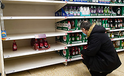 © Licensed to London News Pictures. 15/10/2021. London, UK. A shopper looks at nearly empty shelves of washing up liquid in Sainsbury's, north London, amid fears of food and essential items shortage. The Government and retailers warn that food shortages could continue until Christmas due to labour shortages, following Brexit. Study research, conducted by delivery management experts Urbantz, reports that one in six Londoners reported that when they went food shopping, items they needed were not available and they could not find a replacement, while half of respondents said there was less variety of food in the shops than usual. Another 1-in-6 London residents were also unable to purchase fuel in the last fortnight. Photo credit: Dinendra Haria/LNP