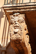 Baroque Sicilian Balcony with sculpted decorated corbels - The Villadorata palace, Noto, Sicily. UNESCO World Heritage Site<br /> <br /> USEFUL LINKS:<br /> Wikipedia https://en.wikipedia.org/wiki/Sicilian_Baroque<br /> Wikipedia https://en.wikipedia.org/wiki/Noto