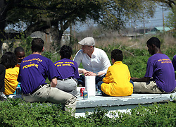 16 March 2008. New Orleans, Louisiana. Lower 9th ward.<br /> Movie star Brad Pitt with students, some former residents for the 'Make a Difference, Make a Commitment' clean up of the neighbourhood devastated by Hurricane Katrina. The massive clean up project was organised by Brad Pitt's Make it Right Foundation aided by the Clinton Global Initiative.<br /> Photo credit; Charlie Varley.