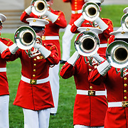 "United States Marine Drum and Bugle Corps, known as ""The Commandant's Own,"" performing at the Marine Corps Sunset Parade at the Marine Corps Memorial (Iwo Jima Memorial) next to Arlington National Cemetery."