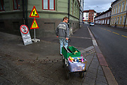 Man taking rubbish on a trolly to the recycling centre on 20th September 2019 in the neighbourhood of Grunerlokka, Oslo, Norway, an area full of colourful street art and markets. Norway is importing as much rubbish as it can get its hands on, in an effort to generate more energy by burning waste in vast incinerators, with 71% of the population supporting the renewable energy source.