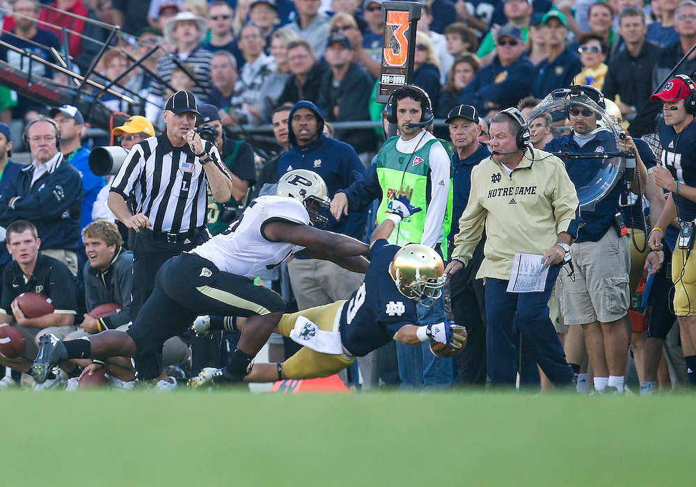 September 08, 2012:  Notre Dame wide receiver Robby Toma (9) dives for the first down market during NCAA Football game action between the Notre Dame Fighting Irish and the Purdue Boilermakers at Notre Dame Stadium in South Bend, Indiana.  Notre Dame defeated Purdue 20-17.