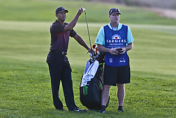 January 25, 2018 - San Diego, California, United States - Tiger Woods (L) and caddie Joe LaCava wait on the 17th fairway during the first round of the 2018 Farmers Insurance Open at Torrey Pines GC. (Credit Image: © Debby Wong via ZUMA Wire)