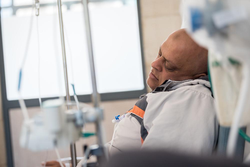 24 February 2020, Jerusalem: Palestinian man Iyad receives chemotherapy treatment at the Augusta Victoria Hospital.