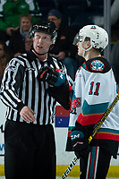 KELOWNA, BC - FEBRUARY 7: Linesman Cody Wanner watches a replay on the jumbotron as Pavel Novak #11 of the Kelowna Rockets weighs in during second period against the Portland Winterhawks at Prospera Place on February 7, 2020 in Kelowna, Canada. (Photo by Marissa Baecker/Shoot the Breeze)