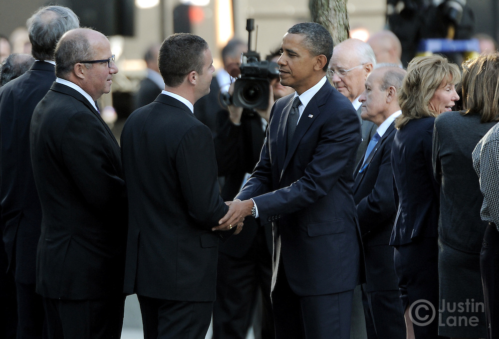 United States President Barack Obama (C) shakes hands with a man near the North Pool of the 9/11 Memorial during tenth anniversary ceremonies at the site of the World Trade Center September 11, 2011, in New York. POOL/Justin Lane/EPA