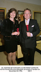 JILL, DUCHESS OF HAMILTON and MR RODDY LLEWELLYN, former friend of Princess Margaret, at a party in London on November 5th 1996.              LTG 9