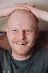 Portrait of male resident of homeless hostel for people with learning difficulties smiling,
