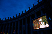 The Cardinal mass on a video screen lead by Pope Francis in the Sistine Chapel is displayed in St. Peter's Square the day after Pope Francis was chosen to be the 266th leader of the Catholic Church in Vatican City, March 14, 2013. Cardinal Jorge Mario Bergoglio from Argentina was chosen by the cardinals during two days of conclave in the Sistine Chapel. Photograph by Todd Korol
